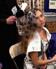 """Miroslava Khater of New Brunswick, N.J., whose hair is dyed in a funky leopard pattern, has her hair done during the recent International Beauty Show in New York. Referring to the color-panel process that produces the animal look, a stylist working on Khater&squot;s hair said: """"Your imagination is the limit."""""""
