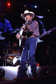 George Strait performs at Adelphia Coliseum in Nashville, Tenn. Strait's latest tour of stadiums is the hottest ticket of the year for country music fans.