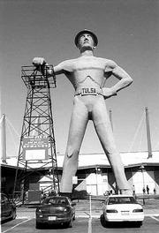 A huge statue of an oil field worker is the landmark of the Oklahoma State Fairgrounds. The Tulsa Flea Market is in the second building behind the statue.