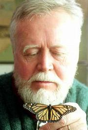 "Orley ""Chip"" Taylor, a professor of biological sciences at Kansas University and founder of Monarch Watch, displays a monarch butterfly. No one is exactly sure why 5 million monarchs recently perished in Mexico."