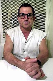 The Supreme Court is scheduled to hear arguments today on the death penalty in the case of condemned murderer Johnny Paul Penry. Penry looks out from a cell at the visiting area of Texas' death row in Livingston, Tex., in this October 2000 file photo. His lawyers contend that jurors who sentenced him to death for raping and killing a woman did not have the chance to properly consider his mental capacity.