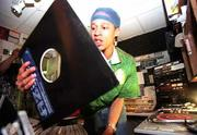 "CGz (Clinton ""CJ"" Wilford) surveys some vinyl while in the midst of a ""Hip Hop Hyp"" segment."