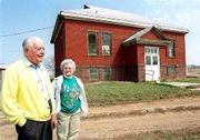 The big Springs Community Assn. wants to restore an old brick schoolhouse, with help from Lecompton Township. Chuck Wright, left, and Iona Spencer, photographed Friday, would like to see the building used for community gatherings.