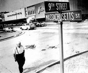 "Lawrence&squot;s historic thoroughfare Massachusetts Street, shown here in the 1970s has served as the city&squot;s ""Main Street"" since the town&squot;s founding in 1854. That year, settlers arrived and christened the city ""Lawrence"" to honor Amos Lawrence, a Free-Stater and major supporter of the New England Emigrant Aid Society which had sponsored the migration to Kansas."