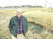 Lou Atherton, president and chief executive officer of the Ottawa Area Chamber of Commerce, stands near the site where American Eagle Outfitters Inc. will open a $31.5 million warehouse and distribution center.