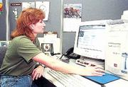 Computer Specialist Ollie McBride, who works for Douglas County's information services department, reworks the county's Web page and keeps it up to date.