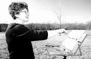 Jane Fortun works on a landscape painting near her southern Jefferson County home.