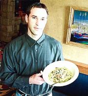 Brad Ziegler shows off one of the new dishes at his latest restaurant, Marisco's. The restaurant, located near the southeast corner of Sixth Street and Wakarusa Drive, features southwestern-style food with a seafood theme.