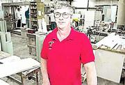 Terry Tolar, owner of Tolar Cabinets, says his business is outgrowing its current space, so he is expanding the carpentry shop to 14,000 square feet at 23rd Street and Haskell Avenue.