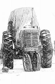 Covered by snow, an old tractor sits in North Lawrence during a late February snow storm. Researchers say new census figures may force the Kansas Legislature to determine whether it should target economic development programs, or accept the population and economic decline in rural areas and not intervene.