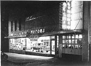Signs gleaming downtown at night, Gallagher Motors circa 1950 advertises one of its new displays the DeSoto. The dealership, owned by the late Buddy Gallagher, was located at 634 Mass., where Kring's Interiors is today.