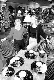 Sisters-in-laws, from left, Diane and Dru Fritzel are co-owners of interiors, 738 Mass., a store that specializes in upscale home furnishings and interior design services.