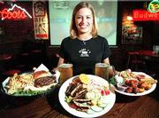 At Henry T's Bar & Grill, 3520 W. Sixth, where servers like Jacque Kerr will greet you with a smile, popular menu items include the half-pound steak burger, blackened grilled chicken salad and the sampler platter appetizer.
