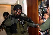Alan Diaz of the Associated Press won the Pulitzer Prize for breaking news photography for this photo of the rescue of Elian Gonzalez. In the photo, Donato Dalrymple, far right, holds 6-year-old Elian during the predawn hours of April 22, 2000, as government agents stormed the Miami home to seize custody of the boy.