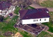 A house sits off its foundation in Hoisington after a tornado ripped through the town late Saturday. Officials estimate that 20 to 25 percent of the buildings in this town of 2,900 people, 100 miles northwest of Wichita, were hit by the twister Saturday night when one person was killed and more than 20 were hurt.