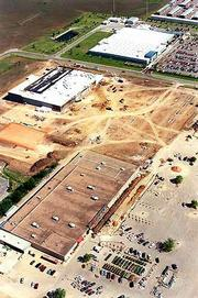 """South Iowa Street is the city&squot;s largest commercial district, more than a decade after city officials rejected plans for a """"cornfield mall"""" in the area. They relied on language in Plan &squot;95 to make their case. In this aerial taken three years ago, crews were building a new Kohl&squot;s department store (center) between Kmart (foreground) and Wal-Mart (top)."""