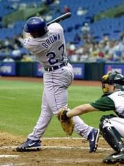 Kansas City's Dee Brown connects for his first career home run against Tampa Bay pitcher Bryan Rekar. The Royals toppled the Devil Rays, 6-0, Thursday at Tropicana Field in St. Petersburg, Fla.