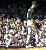 Oakland pitcher tim hudson returns to the mound after giving up a sixth-inning homer to New York's Chuck Knoblauch, left. Knoblauch was 4-for-5 with three RBIs in the Yankees' 7-6 victory on Saturday at New York.