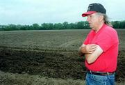 Tom and Marianna Harmon were alarmed this week when city workers injected treated sewage on city fields just off their property line. The city has used the adjacent fields to spread the sludge, but this was too close, Harmon said.