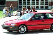 The chance to win a red Honda Civic gets the attention of Free State High School seniors from left, Johanna Carttar, Joy Jackson and Shauntae Rozzelle. The trio of girls inspected the car Monday. It will be given away at Project Graduation 2001, a party at The Granada, 1020 Mass.