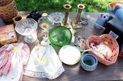 Typical garage sale fare is usually anything but. Dishes, candlesticks and baskets fill a table at one sale.
