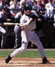 Seattle's Bret Boone hits a three-RBI double. Boone's first-inning two-bagger sparked the Mariners to a 6-2 victory over the Yankees on Sunday in Seattle.