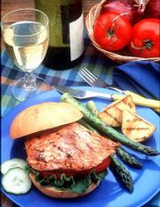 A BBQ Salmon Sandwich is an easy way to serve salmon with a twist it takes the place of a burger, sandwiched in toasted rolls, at the cookout. Serve it with grilled asparagus and potatoes.