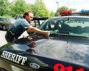 Douglas County's sheriff says the wages his department pays are causing a hardship attracting and keeping officers. One of those who has stayed is Sgt. J.A. Nelson, who was readying his patrol car Thursday afternoon for his daily shift.