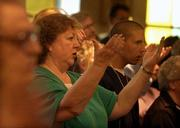 Donna Carlton is one of a growing group of lapsed Catholics returning to the church. Several churches are organizing programs for returning Catholics such as Carlton, who's shown here attending Mass in Pleasanton, Calif.