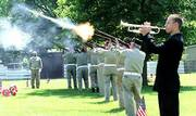 """The playing of """"taps"""" and a Gun salute provide a stirring conclusion to Memorial Day ceremonies in Memorial Park Cemetery. The ceremony Monday was conducted by the Alford-Clarke Post 852 of the Veterans of Foreign Wars."""