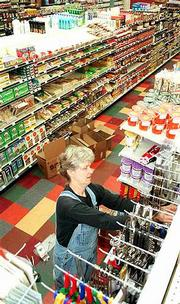 Community Mercantile Co-op plans today to close its current home at 901 Miss., then reopen at 7 a.m. Monday at its new location, 901 Iowa Street. Wednesday, Nancy O'Connor, nutrition educator for the Mercantile, stocked shelves at the Iowa Street location.