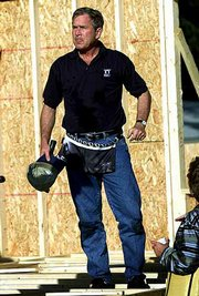 President Bush takes a break from a Habitat for Humanity construction project in Tampa, Fla. The nonprofit, faith-based ministry program that provides housing for low-income Americans, marks its 25th anniversary Tuesday. Bush helped the construction crew for about 30 minutes on Tuesday.