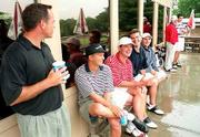 Golfers in the KGA FourBall Championship seek shelter during a rain delay. Cooling their heels Tuesday at Alvamar are, from left, Matt Murray and Andrew Emerson, both of Overland Park; Mark Lambertz, Lake Quivera; Darren Black, Overland Park; and Max Pinney, Shawnee.