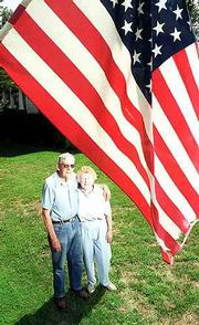 Joy and Clint Clouse, Eudora, would like to see the town's residents fly their flag every day, not just today, which is Flag Day. The Clouses and city council member Rex Burkhardt are spearheading the effort. Wednesday, at their home at 2020 N. 1000 Road, the Clouses fly one of their flags.