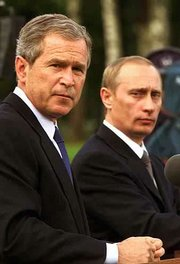 President Bush, left, and Russia's President Vladimir Putin take part in a joint news conference. The two met for the first time Saturday in Slovenia.