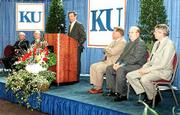 "Tuesday&squot;s gift from the Hall Family Foundation is the latest in a long list of Hall donations to KU. From left, Donald J. Hall, chairman of the foundation and Hallmark Cards Inc. and KU Chancellor Robert Hemenway listen to Forrest Hoglund, chairman of ""KU First"" fund-raising campaign, at podium, along with Clay Blair, chairman of the Kansas Board of Regents, Donald Hagen, executive vice chancellor for the KU Medical Center, and David Shulenburger, KU provost."