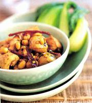 "Spicy Chicken With Peanuts is a quick and easy-to-make version of the western Chinese dish known as ""kung pao"" chicken. It&squot;s featured in ""Foolproof Chinese Cooking"" by chef and food writer Ken Hom."