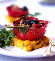 Olives and capers fill Piedmontese Peppers. Served with broiled blue-cheese polenta and arugula salad, these vegetarian peppers make for a nutritious meal.