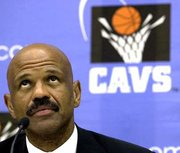 John Lucas, named Tuesday as the Cleveland Cavaliers' head coach, ponders a question during a news conference Tuesday in Cleveland.