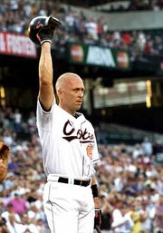Baltimore's Cal Ripken Jr. acknowledges the crowd. Ripken was cheered Tuesday during a game against Toronto at Camden Yards.