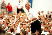 A camper's question brings a smile to the face of Kansas University basketball coach Roy Williams. The question whether Williams had coached at the high school level came Tuesday at Horejsi Center.