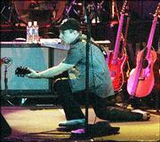 Paul Simon showing off stage moves Tuesday night at Sandstone.