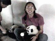 One of Lynn Feng's duties at the Chengdu Research Base in Sichuan, China, is to help with the daily feedings. The Lawrence teen is shown here with Cheng Gong, a female panda cub.