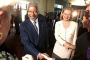 United Nations Secretary-General Kofi Annan and his wife, Nane, right, receive congratulations from U.N. staff outside the General Assembly in New York. Annan on Friday was elected to a second term as head of the organization.