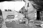 Even on relatively high ground, some houses and property weren't spared from the ravages of the floodwaters. Harry Workman's house, 801 Lake St., sustained substantial damage when the garage collapsed.