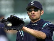 Seattle's Ichiro Suzuki warms up for the Mariners' game Monday at Texas.