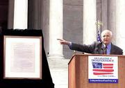 "Producer Norman Lear announces the launch of the Declaration of Independence Road Trip on the steps of the Jefferson Memorial in Washington. Lear, who made the announcement Tuesday, acquired a Dunlap broadside print of the Declaration in June 2000 with the goal of bringing the ""people&squot;s document"" directly to Americans."