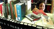 A grant worth $8,671 will enable the library at Kansas University's School of Law to expand its American Indian law collection. Library director Joyce McCray Pearson is shown Tuesday in the American Indian law section of the law library stacks.