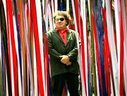 "Artist Dale Chihuly stands amid ""Reeds,"" one of his glass installations, at the Victoria and Albert Museum in London. The artist now has work in more than 180 museums worldwide, including the Helen Foresman Spencer Museum of Art at Kansas University."