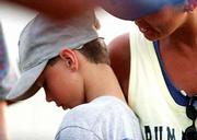 Sulin Sehorn comforts her son, Austin Sehorn, after a close loss last week.